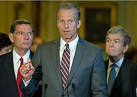 United States Senator John Thune (Republican of South Dakota), center, speaks to reporters following the Republican Party luncheon in the United States Capitol in Washington, DC on Tuesday, July 11, 2017.  From left to right: US Senator John Barrasso (Republican of Wyoming), Senator Thune, and US Senator Roy Blunt (Republican of Missouri). Photo Credit: Ron Sachs/CNP/AdMedia