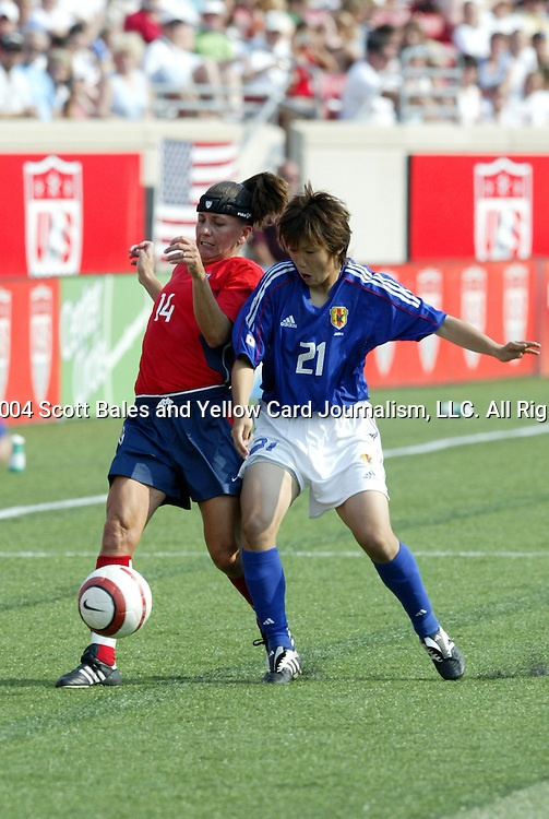 6 June 2004: Joy Fawcett (14) and Ayako Kitamoto (21). The United States tied Japan 1-1 at Papa John's Cardinal Stadium in Louisville, KY in an international friendly soccer game..