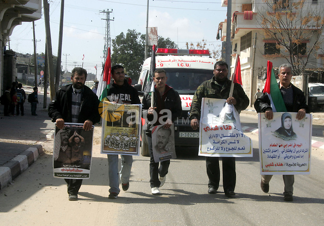 Palestinian Protestors hold a picture of Palestinian prisoner Hana'a Shalabi, in Rafah City, southern Gaza Strip, on Mar. 05, 2012. Photo by Abed Rahim Khatib