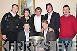 SAM: The Sam Maguire Cup was on display at the Pre Cheltenham Race Night in the Listowel Arms Hotel on Monday. Photographed were, front l-r: Jockeys David Casey and Charlie Swan. Back l-r: Charles and Cora Byrnes, Billy Keane, Pat Healy and Declan Sheehy..