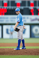 Burlington Royals starting pitcher Travis Eckert (23) looks to his catcher for the sign against the Danville Braves at American Legion Post 325 Field on August 16, 2016 in Danville, Virginia.  The game was suspended due to a power outage with the Royals leading the Braves 4-1.  (Brian Westerholt/Four Seam Images)