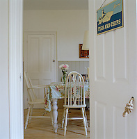 View through the open door into the simply furnished dining room