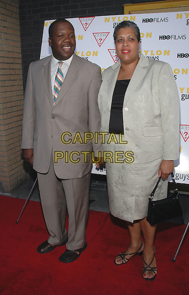 "THADDEUS THOMPSON & WIFE.The premiere of the new film, ""Last Days"".New York, 19th July 2005.full length full-length grey suit skirt couple.Ref: Patti Ouderkirk.www.capitalpictures.com.sales@capitalpictures.com.© Capital Pictures."