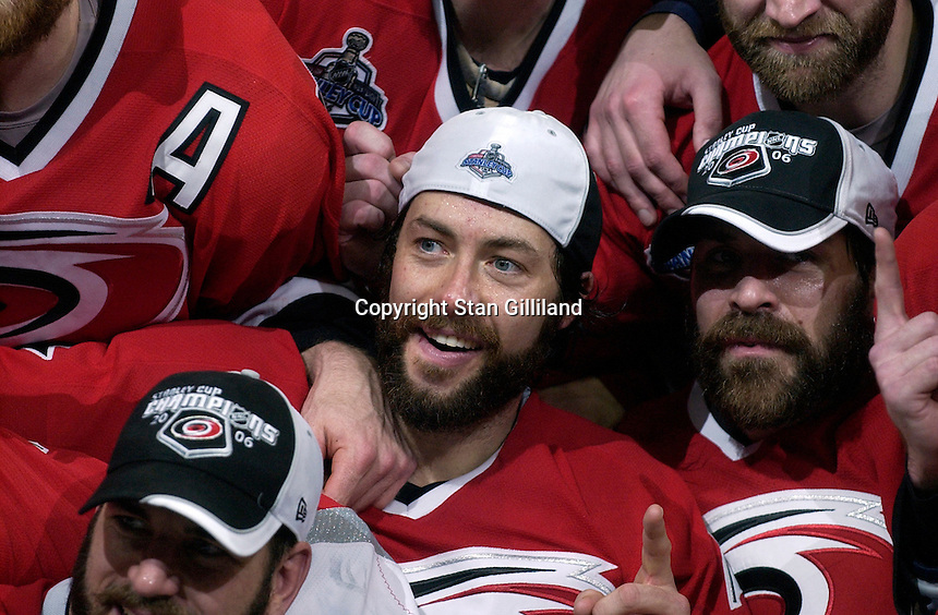 Matt Cullen, center, and Doug Weight, right, gesture to the cameras during a team photo. The Carolina Hurricanes beat the Edmonton Oilers 3-1 in game seven to take the Stanley Cup at the RBC Center in Raleigh, NC Monday, June 19, 2006.