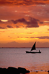 Small sailboat at sunset, Mauritius
