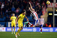 Godin of Atletico de Madrid and Bruno of Villarreal during La Liga match between Atletico de Madrid and Villarreal at Vicente Calderon stadium in Madrid, Spain. December 14, 2014. (ALTERPHOTOS/Caro Marin) /NortePhoto