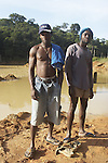 Workers at an unregulated gold mining operation on the Brokopondo reservoir, Suriname.  The man-made lake was hastily created by flooding a vast acreage of jungle without any prior logging and evacuation of animals and is reputed to be polluted by mercury from the mines..