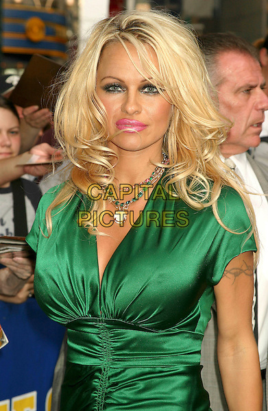 PAMELA ANDERSON.At The David Letterman Show in New York City..August 2, 2004 .half length, breast implants, enlargement, tattoo, green silk, satin top, pink lipstick, beaded necklace.www.capitalpictures.com.sales@capitalpictures.com.©Capital Pictures .