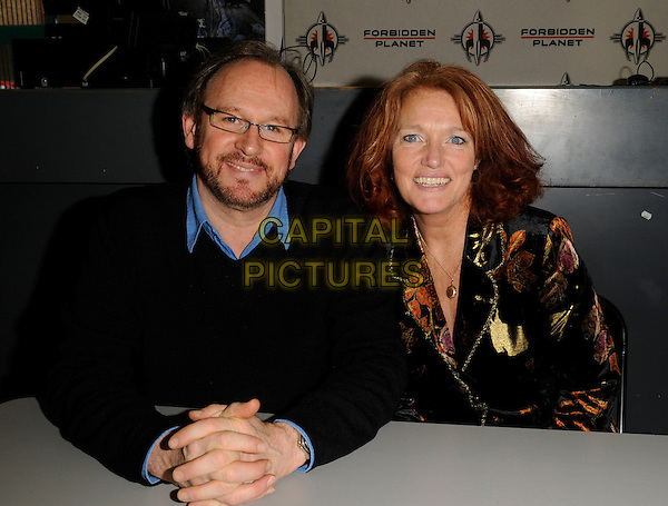 "PETER DAVIDSON & LOUISE JAMESON.At the Dr. Who's New Adventure ""The Bride Of Peladon"" audiobook singing, Forbidden Planet,.London, England, February 2nd 2008..half length sitting .CAP/CAN.?Can Nguyen/Capital Pictures"