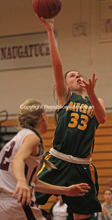 Torrington, CT-122313MK05 Holy Cross' Caitlin Cipriano (33) puts up a shot in front of Torrington's Paige Middleton (12) during NVL basketball action at Torrington High School Monday night.  Holy Cross defeated Torrington 52-43.  Michael Kabelka Republican-American