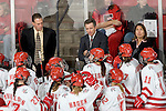MADISON, WI - SEPTEMBER 29: Head coach Mark Johnson (top/center) of the Wisconsin Badgers women's hockey team talks to his team during a break in action against the Quinnipiac Bobcats at the Kohl Center on September 29, 2006 in Madison, Wisconsin. The Badgers beat the Bobcats 3-0. (Photo by David Stluka)
