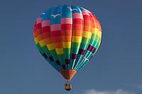 A hot air balloon rises during the Adirondacks Balloon Festival