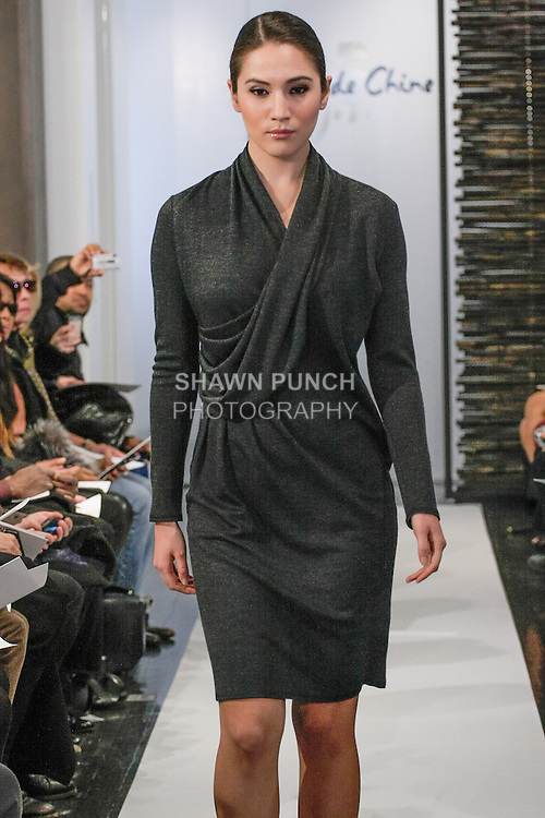 Model walks runway in an outfit from the from the Blanc de Chine Fall Winter 2013 Dunhuang collection, at 673 Fifth Avenue NYC, during New York Fashion Week Fall 2013 on February 10, 2013.