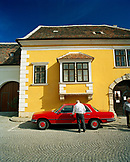AUSTRIA, Rust, a man stands by his red Mercedes in Rust, Burgenland
