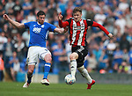 Lukas Jutkiewicz of Birmingham City tackles Lee Evans of Sheffield Utd during the championship match at St Andrews Stadium, Birmingham. Picture date 21st April 2018. Picture credit should read: Simon Bellis/Sportimage