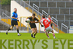 Kieran O'Leary Dr Crokes goes past Patrick Reen Rathmore  during their Club Championship semi final on Sunday