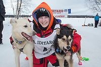 Ksenia Deits poses with her lead dogs at the finish line of the 2016 Junior Iditarod in Willow, Alaska, AK  February 28, 2016
