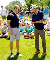 Photo submitted<br /> Alan Anderson of the First Tee of Northwest Arkansas, left, accepts a $200 donation from Siloam Springs Country Club manager Jonathan Self during Junior Golf Camp during the first week of June.