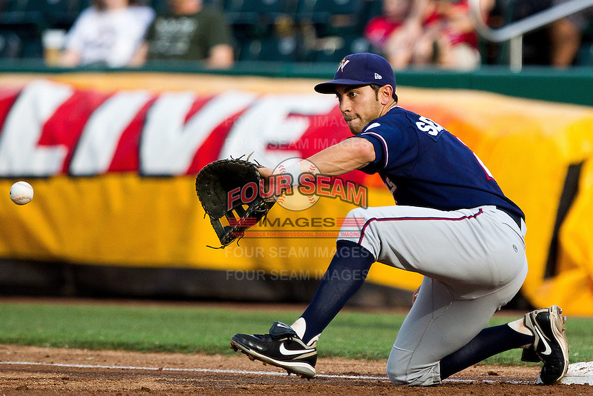 Anthony Seratelli (2) of the Northwest Arkansas Naturals catches a ball thrown to first during a game against the Springfield Cardinals at Hammons Field on July 31, 2011 in Springfield, Missouri. Northwest Arkansas defeated Springfield 9-1. (David Welker / Four Seam Images)