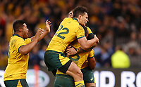 Kurtley Beale of the Wallabies is jumped on by Matt To'omua during the Rugby Championship match between Australia and New Zealand at Optus Stadium in Perth, Australia on August 10, 2019 . Photo: Gary Day / Frozen In Motion