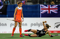 Sam Charlton is pushed to the ground during the World Hockey League final between the Netherlands and New Zealand. North Harbour Hockey Stadium, Auckland, New Zealand. Sunday 26 November 2017. Photo:Simon Watts / www.bwmedia.co.nz
