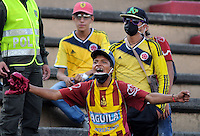 ITAGÜÍ -COLOMBIA-22-03-2014. Aspecto de un hincha del Tolima durante el encuentro entre Itaguí y Deportes Tolima en partido por la fecha 12 de la Liga Postobon I 2014 jugado en el estadio Metropolitano de Itaguí./ Aspect of a fan of Tolima during the match between Itagui and Deportes Tolima for the 12th date of the Postobon League I 2014 played at Metropolitano stadium in Itaguí city.  Photo:VizzorImage/Luis Ríos/STR