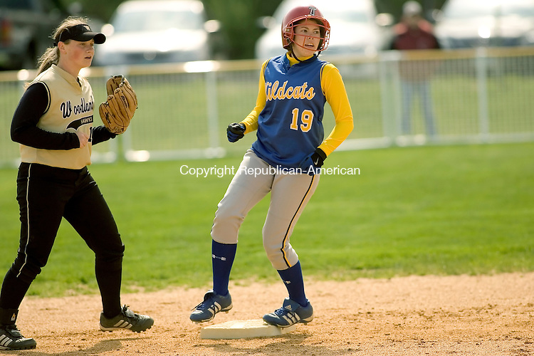 SEYMOUR, CT- 01 MAY 2008 --050108JS02--Seymour's Katie Barsevich (19) gets to second base on a passed ball while Woodland's Aubrey Roulanaitis (16) covers the bag during their game Thursday at Seymour High School. <br /> Jim Shannon / Republican-American