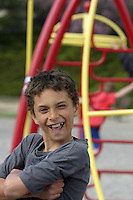 Portrait of a young boy on a playground.