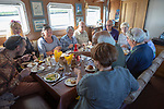 Lady Florence boat trip cruise River Ore, Orford Ness, Suffolk, England people eating meal onboard