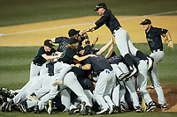 The Wake Forest Demon Deacons celebrate with a dog pile near the pitchers mound after eliminating the West Virginia Mountaineers in Game Six of the Winston-Salem Regional in the 2017 College World Series at David F. Couch Ballpark on June 4, 2017 in Winston-Salem, North Carolina.  The Demon Deacons defeated the Mountaineers 12-8.  (Brian Westerholt/Four Seam Images)