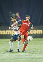 07 March 2012: Toronto FC forward Danny Koevermans #14 and LA Galaxy defender A.J. DeLaGarza #20 in action during a CONCACAF Champions League game between the LA Galaxy and Toronto FC at the Rogers Centre in Toronto.