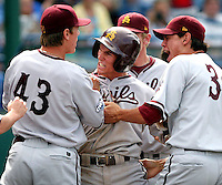 Arizona State's Drew Maggi celebrates with Seth Blair (43) and Jeeter Ishida (36) after scoring to put ASU up 2-1 over UNC in the 10th inning.  A four-run 10th inning lifted ASU to a 5-2 win over North Carolina in the opening round of the 2009 College World Series at Rosenblatt Stadium in Omaha. (Photo by Michelle Bishop)