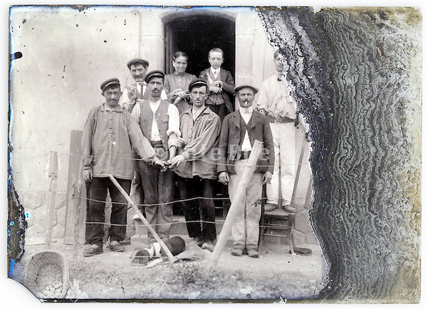 eroding glass plate with farmer family with workers
