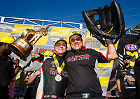 May 7, 2017; Commerce, GA, USA; Crew member Bobby Lagana (right) and NHRA top fuel driver Steve Torrence celebrate after winning the Southern Nationals at Atlanta Dragway. Mandatory Credit: Mark J. Rebilas-USA TODAY Sports
