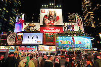 Times Square Billboards, Advertising, People, New York City. Gap Ad, Cold Model. Line of Concert Goers to the Nokia in Foreground. Cold November Night.