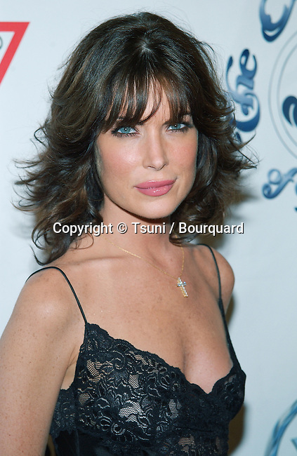 Lara Flynn Boyle arriving at the Carousel of Hope which support the Barbara Davis Center for Childhood Diabetesat the Beverly Hilton in Los Angeles. October 15, 2002.