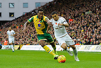 Andre Wisdom of Norwich City and Jefferson Montero of Swansea City during the Barclays Premier League match between Norwich City and Swansea City played at Carrow Road, Norwich on November 7th 2015