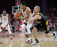NWA Democrat-Gazette/ANDY SHUPE<br /> Arkansas guard Jalen Harris (5) looks to pass Saturday, Nov. 30, 2019, as Northern Kentucky guard Tyler Sharpe reaches to tip the ball during the second half of play in Bud Walton Arena. Visit nwadg.com/photos to see more photographs from the game.