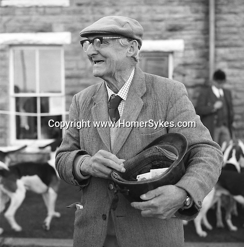 The Blencathra Foxhounds. Dick Peel collects the cap. Dick usually collects around £120 in cap money, which goes towards the upkeep of the hounds. Hesket Newmarket, Cumbria..Hunting with Hounds / Mansion Editions (isbn 0-9542233-1-4) copyright Homer Sykes. +44 (0) 20-8542-7083. < www.mansioneditions.com >