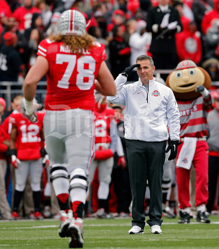 Ohio State Buckeyes head coach Urban Meyer salutes Ohio State Buckeyes offensive linesman Andrew Norwell (78) during  senior day before the start of their game against Indiana Hoosiers at Ohio Stadium in Columbus, Ohio on November 23, 2013.  (Dispatch photo by Kyle Robertson)