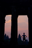 Tourist watching the sunrise over Angkor Wat, cambodia