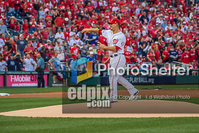 7 October 2016: Washington Nationals catcher Wilson Ramos (injured, and recovering from a torn ACL) throws out the ceremonial first pitch prior to the first game of the NLDS between the Washington Nationals and the Los Angeles Dodgers at Nationals Park in Washington, DC. The Dodgers edged out the Nationals 4-3 to take the opening game of their best-of-five series. Mandatory Credit: Ed Wolfstein Photo *** RAW (NEF) Image File Available ***