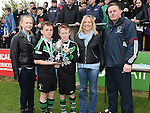 Albion Rovers captain Keith McCloskey and Sam McCaufield receive the Eddie Maher trophy from Aontoine and Sarah Maher and secretary of the Dustrict League Donal Townley after beating Dromin Utd in the under 12s schoolboys cup final in United Park . Photo:Colin Bell/pressphotos.ie