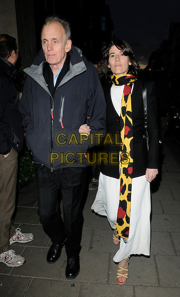 GUEST & BELLA FREUD .Attending the 50 Years in Vogue Gala Dinner, Claridge's hotel, London, England, UK, May 11th 2010..full length black jacket white dress red yellow print knitted knit scarf bag long maxi dress beige cream sandals open toe .CAP/CAN.©Can Nguyen/Capital Pictures.