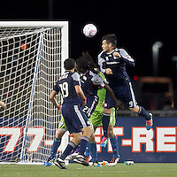 New England Revolution forward Milton Caraglio (9) heads a corner kick. In a Major League Soccer (MLS) match, the Seattle Sounders FC defeated the New England Revolution, 2-1, at Gillette Stadium on October 1, 2011.