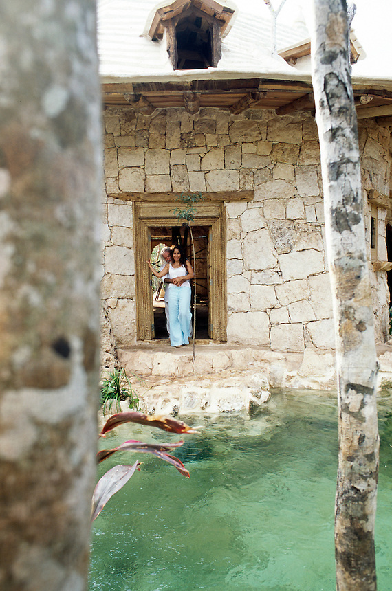 Amalia and  Memo at one of the side doors of a house which opens at the foot of the cenote pool surrounding it. Photos for Jasai´s catalogue of the houses of Memo and the surrounding area