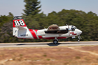 S-2F3AT Tracker, CDF 88, returns to Grass Valley Air Attack Base in Northern California after dropping is load of Phos-Chex on a wildfire