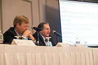 "Nuclear Regulatory Commission officials speak at a public hearing regarding Pilgrim Station, a nuclear power plant run by Entergy, at Hotel 1620 in Plymouth, Massachusetts, USA, on Tues., Jan. 31, 2017. The officials at the meeting are, from left, Dan Dorman, NRC Region 1 Regional Administrator and Don Jackson, 95003 Team Lead in the NRC Region 1 Division of Reactor Safety. Not pictured are  Ray Lorson, Director of NRC Region 1 Division of Reactor Safety and Bill Dean, Director of NRC Office of Nuclear Reactor Regulation. An email from Don Jackson was leaked in December 2016 outlining problems with the ""safety culture"" at the plant and an ""overwhelmed"" staff. Area residents have been calling for the plant to be shut down. The green signs in the audience, reading ""Shut Pilgrim Now,"" are from a group of area residents calling for the plant's closure called Cape Downwinders."