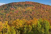 Early morning sun on Little Coolidge Mountain in Lincoln, New Hampshire on a autumn morning. This mountainside was logged during the East Branch & Lincoln Railroad era.