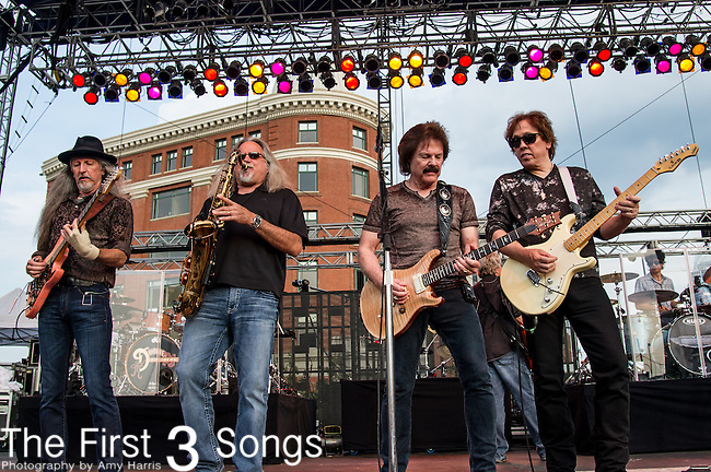 Tom Johnston, John McFee, Patrick Simmons, and Marc Russo of the The Doobie Brothers performs at the Horseshoe Casino in Cincinnati, Ohio.